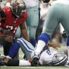 Dallas Cowboys quarterback Tony Romo (9) lies on the turf after a tough hit by Tampa Bay Buccaneers defensive end Michael Bennett (71) during the second half of an NFL football game on Sunday, Sept. 23, 2012, in Arlington, Texas. (AP Photo/LM Otero)
