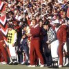 OU COLLEGE FOOTBALL: Barry Switzer, center, has a sideline view to a Sooner touchdown- and eventual national title- last season.
