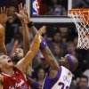 Los Angeles Clippers\' Blake Griffin,left, goes up for a basket against the Phoenix Suns\' Markieff Morris, center, and Jermaine O\'Neal in the first half of an NBA basketball game at the US Airways Center in Phoenix, Ariz., Sunday Dec. 23, 2012. (AP Photo/The Arizona Republic, Patrick Breen)