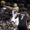 San Antonio Spurs\' Tony Parker (9) shoots against Miami Heat\'s Chris Bosh (1) during the first half at Game 4 of the NBA Finals basketball series, Thursday, June 13, 2013, in San Antonio. (AP Photo/Eric Gay)
