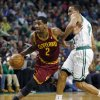 Photo - Cleveland Cavaliers' Kyrie Irving (2) drives past Boston Celtics' Avery Bradley (0) in the first quarter of an NBA basketball game in Boston, Saturday, Dec. 28, 2013. The Celtics won 103-100. (AP Photo/Michael Dwyer)