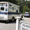 A Boston Police crime scene response van enters the Puritan Lawn Memorial Park Cemetery in Peabody, Mass., where authorities plan to exhume Albert DeSalvo\'s body from a grave to confirm a forensic link to the Boston Strangler case, Friday, July 12, 2013. DeSalvo was the man who first confessed to being the Boston Strangler, but later recanted before his stabbing death in prison as he served a life sentence for other crimes. (AP Photo/Bizuayehu Tesfaye)