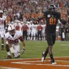 Oklahoma State\'s Justin Blackmon (81) celebrates in front of Stanford\'s Delano Howell (26) and Harold Bernard (28) during the Fiesta Bowl between the Oklahoma State University Cowboys (OSU) and the Stanford Cardinal at the University of Phoenix Stadium in Glendale, Ariz., Monday, Jan. 2, 2012. Photo by Sarah Phipps, The Oklahoman