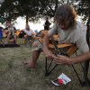 Jody Thom, of Fayetteville, Ark., replaces his guitar strings near his camp site during the Woody Guthrie Folk Festival in Okemah, Okla., Thursday, July 12, 2012. Photo by Garett Fisbeck, The Oklahoman