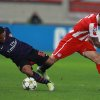Olympiakos\' Paulo Machado, right, fights for the ball with Arsenal\'s Jernande Meade during their group B Champions League soccer match in the port of Piraeus, near Athens, Tuesday, Dec. 4, 2012. (AP Photo/Thanassis Stavrakis)