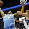 Denver Nuggets\' Andre Iguodala, left, lays up as Minnesota Timberwolves\' Andrei Kirilenko, of Russia, defends in the second half of an NBA basketball game on Wednesday, Nov. 21, 2012, in Minneapolis. The Nuggets won 101-94. Iguodala scored18 points. (AP Photo/Jim Mone)