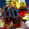 Fair-goers enjoy rides on Wednesday night. Photo by Bryan Terry, The Oklahoman