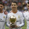 Photo - Real Madrid's Cristiano Ronaldo from Portugal, centre, holds his FIFA Men's World Player of the Year award, as he poses with his team mates before a Spanish La Liga soccer match between Real Madrid and Granada at the Santiago Bernabeu stadium in Madrid, Spain, Saturday, Jan. 25, 2014. Cristiano Ronaldo was named FIFA Men's World Player of the Year on Jan. 13. (AP Photo/Andres Kudacki)