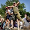 HAND-FISHERMAN / NOODLER: Marion Kincaid of Peru, Kansas unloads a catfish during the Okie Noodling Tournament in Pauls Valley, Okla., Saturday, July 11, 2009. Photo by Bryan Terry, The Oklahoman ORG XMIT: KOD