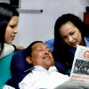 In this photo released Friday, Feb. 15, 2013 by Miraflores Presidential Press Office, Venezuela\'s President Hugo Chavez, center, poses for a photo with his daughters, Maria Gabriela, left, and Rosa Virginia as he holds a copy of Cuba\'s state newspaper at an unknown location in Havana, Cuba, Thursday, Feb. 14, 2013. Chavez remains in Havana undergoing unspecified treatments following his fourth cancer-related operation on Dec. 11. He has hasn\'t been seen or spoken publicly in more than two months. (AP Photo/Miraflores Presidential Press Office)