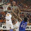 Oklahoma State \'s Michael Cobbins (20) and Marcus Smart (33) battle for a rebound with Kansas\' Kevin Young (40) during the college basketball game between the Oklahoma State University Cowboys (OSU) and the University of Kanas Jayhawks (KU) at Gallagher-Iba Arena on Wednesday, Feb. 20, 2013, in Stillwater, Okla. Photo by Chris Landsberger, The Oklahoman