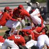 Carl Albert players jump on top of each other near the pitcher\'s mound after winning the Class 5A high school state championship baseball game at Edmond Santa Fe High School Saturday afternoon, May 11, 2013. Photo by Jim Beckel, The Oklahoman.