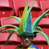 I spectator wears a fancy hat in the stands before the group E World Cup soccer match between Switzerland and Ecuador at the Estadio Nacional in Brasilia, Brazil, Sunday, June 15, 2014. (AP Photo/Fernando Llano)