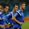 Photo - Bosnia's Edin Dzeko, right, runs with teammates during a training session at the Arena Pantanal in Cuiaba, Brazil, Friday, June 20, 2014. Bosnia plays in group F of the Brazil 2014 soccer World Cup. (AP Photo/Fernando Llano)
