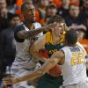 Oklahoma State\'s Kamari Murphy (21) and Markel Brown (22) defend Baylor\'s Brady Heslip (5) during an NCAA college basketball game between Oklahoma State University (OSU) and Baylor at Gallagher-Iba Arena in Stillwater, Okla., Saturday, Feb. 1, 2014. Baylor won 76-70. Photo by Bryan Terry, The Oklahoman