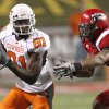 OSU\'s Justin Blackmon runs past Louisiana-Lafayette\'s Devon Lewis-Buchanan during the football game between the University of Louisiana-Lafayette and Oklahoma State University at Cajun Field in Lafayette, La., Friday, October 8, 2010. Photo by Bryan Terry, The Oklahoman