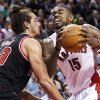 Toronto Raptors forward Amir Johnson (15) drives into Chicago Bulls forward Joakim Noah during the first half of their NBA basketball game, Wednesday, Jan. 16, 2013, in Toronto. (AP Photo/The Canadian Press, Nathan Denette)