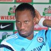 Photo - Chelsea's  Didier Drogba sits on the bench prior to the preseason soccer match between SV Werder Bremen and FC Chelsea, in Bremen, northern Germany, Sunday Aug. 3, 2014.   (AP Photo/dpa, Carmen Jaspersen)
