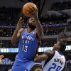 Oklahoma City\'s James Harden (13) goes past Ian Mahinmi (28) of Dallas during game 2 of the Western Conference Finals in the NBA basketball playoffs between the Dallas Mavericks and the Oklahoma City Thunder at American Airlines Center in Dallas, Thursday, May 19, 2011. Photo by Bryan Terry, The Oklahoman