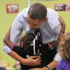 United States President Barack Obama gets a hug from a child at College Heights Early Childhood Learning Center, in Decatur, Ga., on Thursday, Feb. 14, 2013. He visited the school to highlight their pre-kindergarten program. He is proposing a nationwide initiative for children in pre-kindergarten. (AP Photo/Atlanta Journal-Constitution, Johnny Crawford, Pool)