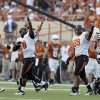 Oklahoma State\'s Daytawion Lowe (8) and Richetti Jones (99) celebrate a fumble recovery during second half of a college football game between the Oklahoma State University Cowboys (OSU) and the University of Texas Longhorns (UT) at Darrell K Royal-Texas Memorial Stadium in Austin, Texas, Saturday, Oct. 15, 2011. Photo by Sarah Phipps, The Oklahoman