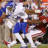 OU\'s Rashod Favors (10) brings down KU\'s Michael Cummings (14) during the college football game between the University of Oklahoma Sooners (OU) and the Kansas Jayhawks (KU) at Gaylord Family-Oklahoma Memorial Stadium in Norman, Okla., Saturday, Oct. 20, 2012. Photo by Bryan Terry, The Oklahoman