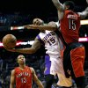 Phoenix Suns\' Marcus Morris (15) is fouled by Toronto Raptors\' Amir Johnson, right, during the second half of an NBA basketball game, Wednesday, March 6, 2013, in Phoenix. (AP Photo/Matt York)