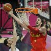 Spain\'s Pau Gasol shoots against United States\' Kevin Love during the men\'s gold medal basketball game at the 2012 Summer Olympics, Sunday, Aug. 12, 2012, in London. (AP Photo/Matt Slocum)