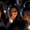 A young woman cries during the candlelight vigil on Saturday night, Oct. 13, 2012, at the Bay State Commons, for Westboro\'s Elizabeth