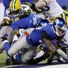 New York Giants\' Andre Brown (35) dives for a touchdown during the first half of an NFL football game against the Green Bay Packers, Sunday, Nov. 25, 2012, in East Rutherford, N.J. (AP Photo/Kathy Willens)