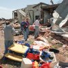 In this May 1999 photograph, members of Ridgecrest Baptist Church in Bridge Creek remove toys and furniture from the church\'s day-care center that was destroyed by a tornado about 45 minutes after the children left. DAVID MCDANIEL