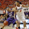 OSU\'s Tiffany Bias (3) knocks the ball away from James Madison\'s Tarik Hislop (22) during the Women\'s NIT championship college basketball game between Oklahoma State University and James Madison at Gallagher-Iba Arena in Stillwater, Okla., Saturday, March 31, 2012. Photo by Nate Billings, The Oklahoman