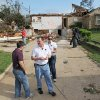 Mark Fox, center, National Weather Service Warning & Coordination Meteorologist, and his staff, look over the damage in the neighborhood after a severe storm passed the area, Wednesday, April 4, 2012 in Arlington, Texas. Preliminary findings indicate one of the tornadoes that struck North Texas had wind gusts ranging from 136 to 165 mph. As many as a dozen twisters touched down across Dallas-Fort Worth. Thousands remained without power Wednesday and hundreds of homes were severely damaged. Officials reported more than 20 injuries, but no deaths. (AP Photo/The Fort Worth Star-Telegram, Paul Moseley) MANDATORY CREDIT ORG XMIT: TXFOR105