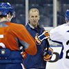 Edmonton Oilers coach Ralph Krueger talks with Ladislav Smid, left, and Eric Belanger during the NHL hockey team\'s training camp in Edmonton, Alberta, on Monday, Jan. 14, 2013. (AP Photo/The Canadian Press, Jason Franson)