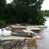 The Chesapeake Boat House dock as it appeared after it was dislodged during Monday\'s storm. It came to rest near NE 36 on the other side of the Oklahoma River dam. Photo provided