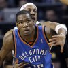 Kevin Durant is guarded by Paul Pierce during the Thunder\'s win in Boston in March. AP photo