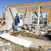 Rick Smith, warning coordination meteorologist, National Weather Service Forecast Office, Norman, looking at house damage to rate the tornado intensity on Brock Road in Lone Grove, Wednesday, Feb. 11, 2009. BY PAUL B. SOUTHERLAND, THE OKLAHOMAN