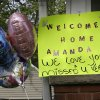 Photo - A sign hangs on the porch of the home of Amanda Berry Wednesday, May 8, 2013, in Cleveland. Berry, 27, Michelle Knight, 32, and Gina DeJesus, had apparently been held captive in a house since their teens or early 20s, police said. (AP Photo/Tony Dejak)