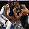 San Antonio\'s Tim Duncan (21) works against Oklahoma City\'s Kevin Durant (35) during an NBA basketball game between the Oklahoma City Thunder and the San Antonio Spurs at Chesapeake Energy Arena in Oklahoma City, Thursday, April 4, 2013. Photo by Nate Billings, The Oklahoman
