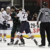 OKC\'s Triston Grant (23) and Houston\'s Matt Kassian (42) fight during a game between the Oklahoma City Barons and the Houston Aeros at the Cox Convention Center in Oklahoma City, Saturday, Dec. 17, 2011. Photo by Garett Fisbeck, The Oklahoman ORG XMIT: KOD