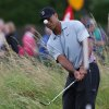 Photo - Tiger Woods of the US watches his shot on the practice chipping green ahead of the British Open Golf championship at the Royal Liverpool golf club, Hoylake, England, Wednesday July 16, 2014. The British Open Golf championship starts Thursday July 17. (AP Photo/Jon Super)