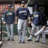 Milwaukee Brewers\' Matt Garza (22) walks in the dugout after leaving a baseball game against the St. Louis Cardinals due to an injury during the fourth inning Wednesday, April 30, 2014, in St. Louis. (AP Photo/Jeff Roberson)