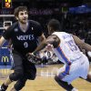 Photo - Minnesota Timberwolves guard Ricky Rubio (9) is fouled by Oklahoma City Thunder guard Reggie Jackson (15) as he drives during the first quarter of an NBA basketball game in Oklahoma City, Wednesday, Feb. 5, 2014. (AP Photo/Sue Ogrocki)