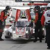 Photo - The crew of the DeltaWing DWC13 make adjustments during a pit stop at practice for the IMSA Series Rolex 24 hour auto race at Daytona International Speedway in Daytona Beach, Fla., Thursday, Jan. 23, 2014. (AP Photo/John Raoux)