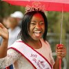 Marla Bailey, Miss Black OU 2013 carries an umbrella as she rides in the Homecoming parade before a college football game between the University of Oklahoma Sooners (OU) and the Texas Tech Red Raiders at Gaylord Family-Oklahoma Memorial Stadium in Norman, Okla., on Saturday, Oct. 26, 2013. Photo by Steve Sisney, The Oklahoman