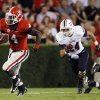 Photo -   Georgia running back Keith Marshall (4) breaks away from Florida Atlantic Owls safety Brent Harstad (24) for a long gain during the first half of an NCAA college football game Saturday, Sept. 15, 2012, in Athens, Ga. (AP Photo/John Bazemore)