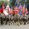 Boy Scouts march with flags during the annual LibertyFest Fourth of July Parade in downtown Edmond, OK, Thursday, July 4, 2013, Photo by Paul Hellstern, The Oklahoman