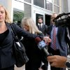 Photo - Maureen McDonnell, center, and two of her lawyers, Heather Martin, left, and Stephen Michael Hauss, (partially hidden by camera) right, leave the Federal Courthouse in Richmond, Va., Tuesday, July 29, 2014. McDonnell and her husband, former Gov. Bob McDonnell, are charged in a 14-count indictment with accepting more than $165,000 in loans, designer clothes, vacations and a Rolex watch from Jonnie Williams, the CEO of dietary supplements maker Star Scientific. (AP Photo/Richmond Times-Dispatch, Bob Brown)