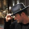 Adam Caine tries on a hat at Goorins Hat Store in Uptown, Minneapolis, December 20, 2012. (Tom Wallace/Minneapolis Star Tribune/MCT)