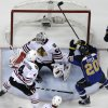 Photo - St. Louis Blues' Alexander Steen (20) scores the game-winning goal past Chicago Blackhawks goalie Corey Crawford and Niklas Hjalmarsson (4) during the third overtime in Game 1 of a first-round NHL hockey Stanley Cup playoff series Thursday, April 17, 2014, in St. Louis. The Blues won 4-3 in triple overtime. (AP Photo/Jeff Roberson)